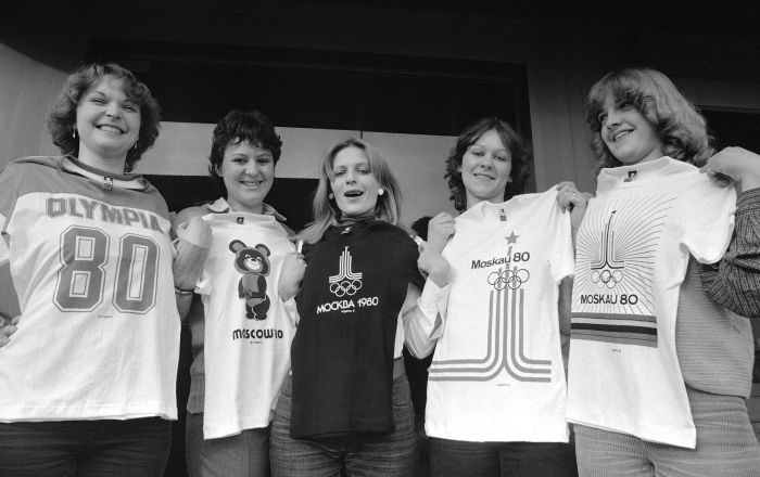 Models of clothing plant near Stuttgart  Feb. 1, 1980 hold five different t-shirts with emblems of the Moscow Olympics 1980 which are produced by the factory for German language countries. According to factory manager there was no loss in selling Olympic souvenirs so far, unaffected by boycott plans of Western countries